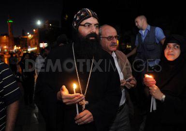 Kristian Koptik di Palestin melakukan Candlelight Vigil